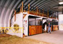 Armor Steel Buildings has Equestrian products to fit any budget.  The S-Series steel panel arch building allows for stalls to be constructed at the sides, without the interference of the large frames from the I-beam design.  The clear heights in the ceiling allows for the hay or additional storage in the loft.